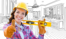 Female Construction Worker With Thumbs Up Holding Level In Front Stock Photo