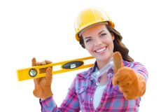 Female Construction Worker in Hard Hat Holding Level Gives Thumbs Up. Young Female Construction Worker with Thumbs Up Holding Level Wearing Gloves, Hard Hat and royalty free stock photography