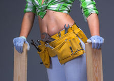 Female Construction Worker With Toolbelt. Isolated On White. Female Construction Worker With Toolbelt. Close up view Stock Photos