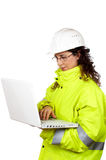 Female construction worker write in a laptop Stock Photography