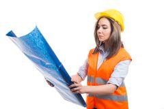 Female constructor or architect holding blueprints. Isolated on white background Stock Photo