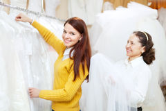 Female consultant helps bride  at shop Stock Photos
