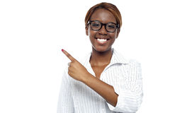 Female consultant pointing at copy space area Stock Photography