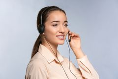 Female consulting manager with headset. On light background stock photography