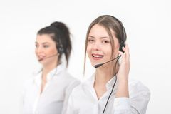 Female consulting manager with headset on light background. royalty free stock image