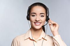 Female consulting manager with headset. On light background royalty free stock image