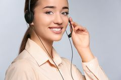 Female consulting manager with headset. On light background royalty free stock photo