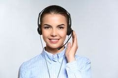 Female consulting manager with headset. On light background royalty free stock photography