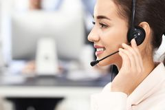 Female consulting manager with headset. In office stock image