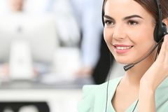 Female consulting manager with headset. In office Stock Photo