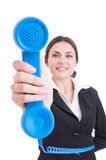 Female contact person showing classic telephone. As assistance or support concept isolated on white background Royalty Free Stock Photography
