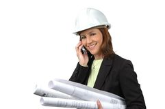 Female contractor on the cell Stock Images