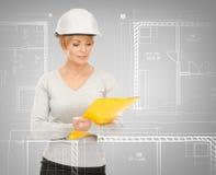 Female contractor in helmet Stock Photos