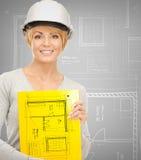 Female contractor in helmet Stock Images
