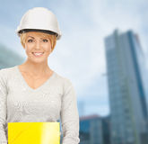 Female contractor in helmet with bluepring Royalty Free Stock Photography