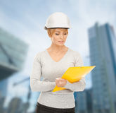 Female contractor in helmet with blueprint Stock Photography