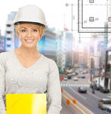 Female contractor in helmet with folder Royalty Free Stock Photography