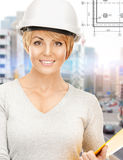 Female contractor in helmet with folder royalty free stock images