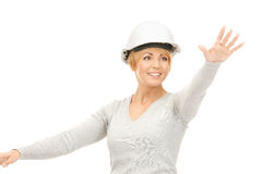 Female contractor in helmet working with something imaginary Royalty Free Stock Photo