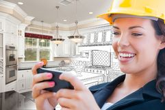 Female Contractor Texting on Phone Over Kitchen Drawing Gradating to Photo. Female Contractor Texting on Her Smart Phone Over Kitchen Drawing Gradating to Photo stock photo