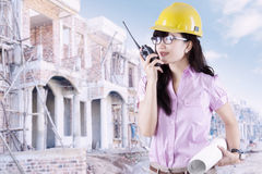 Female contractor with walkie-talkie Royalty Free Stock Image