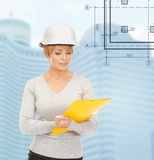 Female contractor in white helmet with files Royalty Free Stock Photo