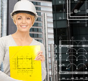 Female contractor in white helmet with files Stock Photos