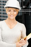 Female contractor in white helmet with files Royalty Free Stock Photos