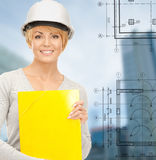 Female contractor in white helmet with files Royalty Free Stock Images