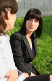 Female conversation. Business women talk in park Stock Image