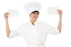 Female cook with blank cards Royalty Free Stock Photography