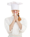 Female cook blowing runny nose Stock Photography