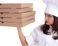 Female cook with boxes of pizza Stock Photos