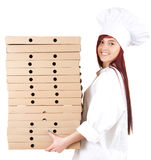 Female cook with boxes of pizza Stock Images