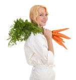 Female cook with bunch of carrots Royalty Free Stock Photo