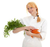 Female cook with bunch of carrots Stock Photography