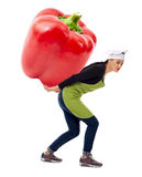 Female cook carrying huge pepper Stock Photography