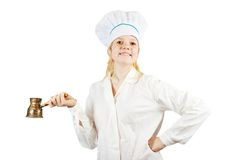 Female cook with  cezve Stock Images