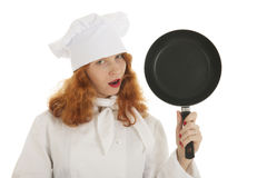 Female cook chef with frying pan Royalty Free Stock Image