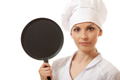 Female cook / chef in white uniform with pan Stock Images