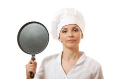 Female cook / chef in white uniform with pan Royalty Free Stock Images