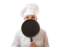 Female cook / chef in white uniform with pan Royalty Free Stock Photo