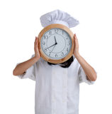 Female cook with clock head Royalty Free Stock Photo