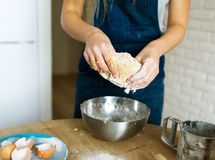The female cook cooks dough for pastries Royalty Free Stock Photography
