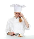Female cook cutting onion Royalty Free Stock Photos