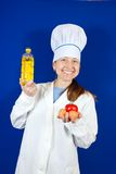 Female cook with different foods Stock Images