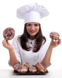 Female cook with donuts Stock Photo