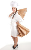 Female cook with ecological paper bags Royalty Free Stock Photo