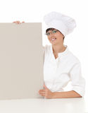 Female cook with empty whiteboard Royalty Free Stock Images