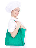 Female cook with green bag Royalty Free Stock Images